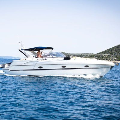 featured image of boat in water for winterize your marine diesel article